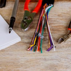 insulation-strippers-set-of-electric-wires-nippers-on-blue-background-electricity-concept-insulation_t20_goyYpz